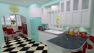 A throwback to another era, this retro kitchen has the checkered floor, chrome accents, vintage appliances, and bright whites, teals, and reds that reminisce of a 50's diner.