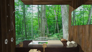 This Japanese inspired bath features a soaking tub elevated on a platform and open shower with teak flooring while opening to a lush scene of greenery with its full height seamless windows.
